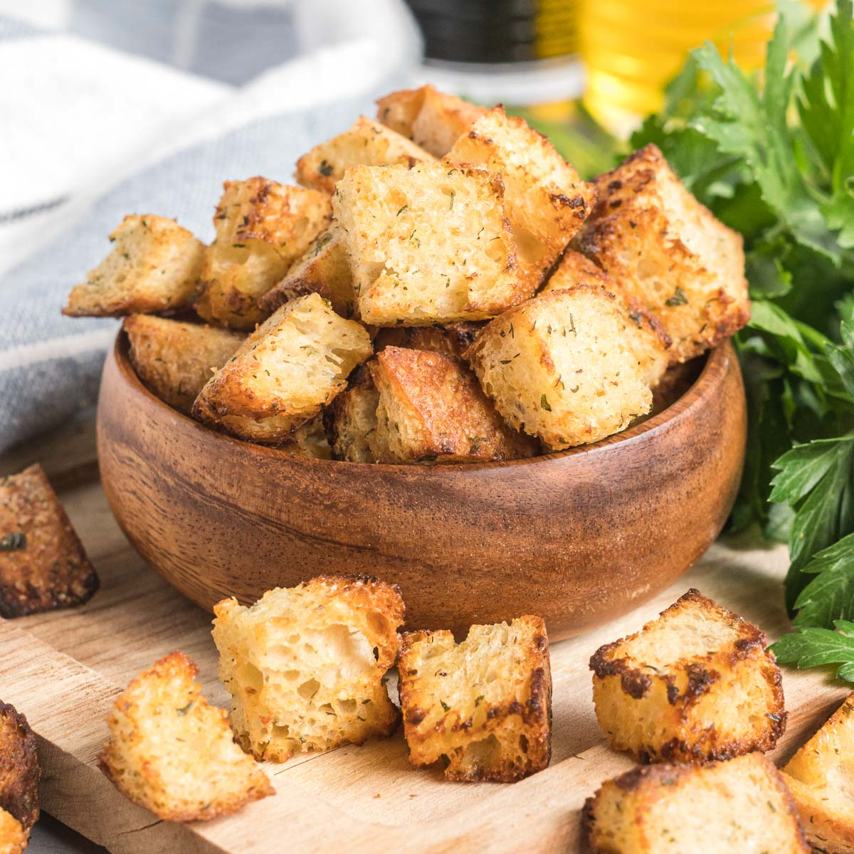 Croutons in a small wooden bowl.