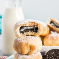 Air fried oreos in a stack with a bite out of the top oreo.
