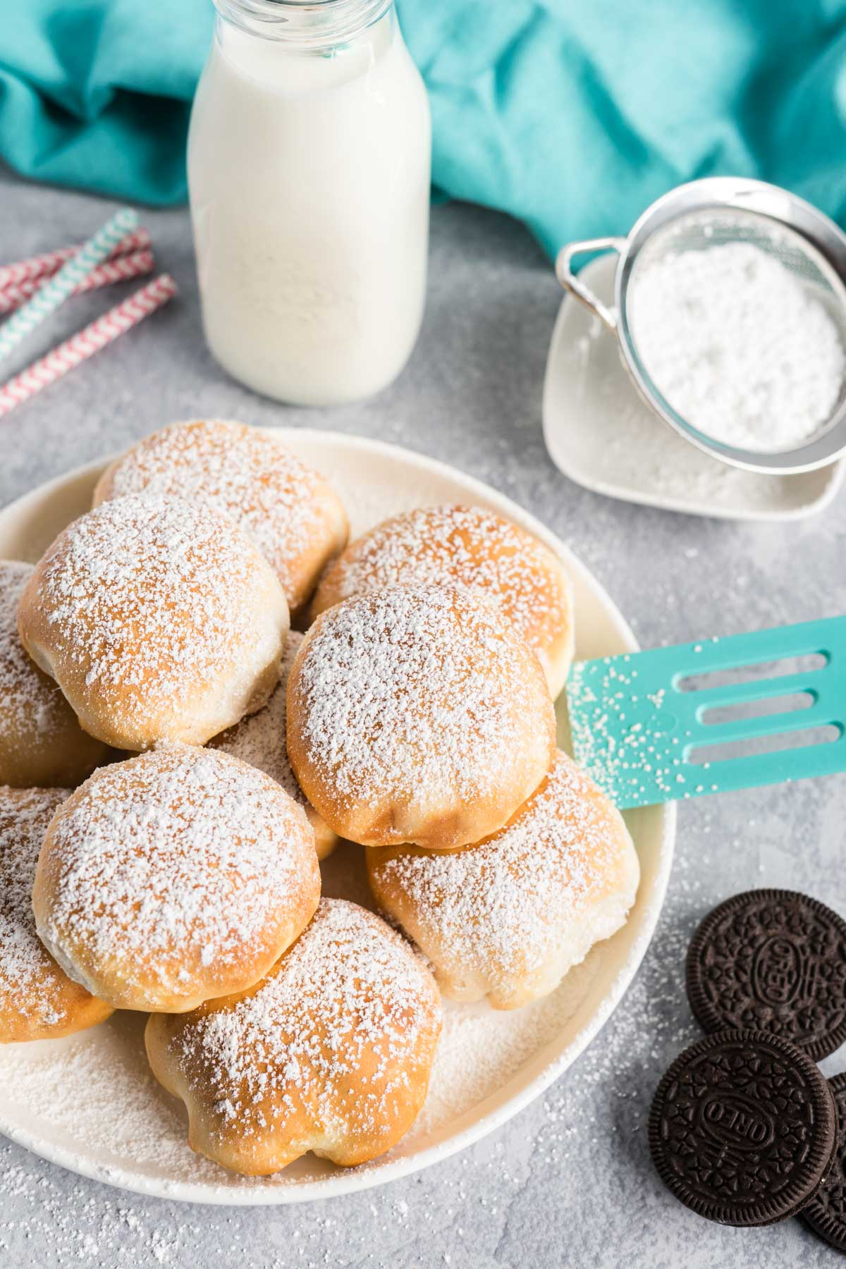 A plate of air fried Oreos with a glass of milk.